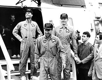 The crew of Apollo 13 on board the USS Iwo Jim...