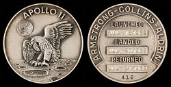 Apollo 11 mission emblem (front). Crew names, dates (launch, lunar landing, and return), and serial number 416 (back)