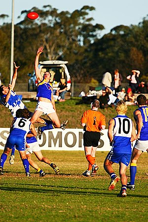 Ruckman (Australian rules football) - Two ruckmen contest the bounce in a suburban western Sydney AFL game between the East Coast Eagles AFC and Campbelltown Kangaroos AFC