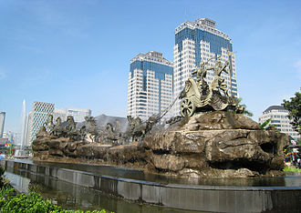 Bhagavad Gita - The thematic story of Arjuna and Krishna at the Kurushetra war became popular in southeast Asia as Hinduism spread there in the 1st-millennium CE. Above, an Arjuna-Krishna chariot scene in Jakarta center, Indonesia.