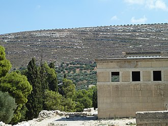 Knossos - View to the east from the northwest corner. In the foreground is the west wall of the Lustral Basin.