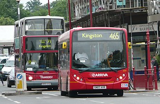 Surbiton - A London double-decker bus and an Abellio Surrey bus in Surbiton.