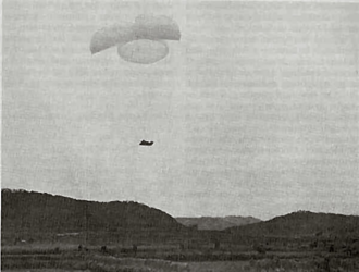 Battle of Yongju - US artillery being airdropped near Sukchon, North Korea