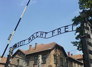 Arbeit Macht Frei at Auschwitz, with the inver...
