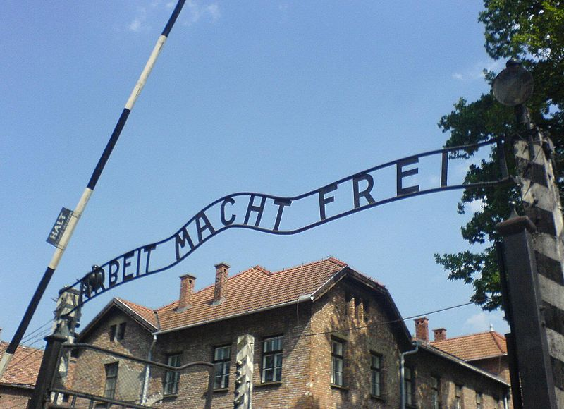 Arbeit Macht Frei at Auschwitz, with the inverted B
