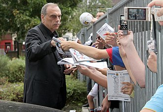 Avram Grant - Avram Grant signing autographs post match West Ham United v Bolton Wanderers 21 August 2010