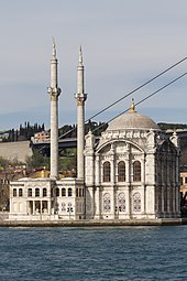A building with two visible minarets, one dome, and an intricate façade; it is designed by Garabet Balyan and his son Nigoğos Balyan.