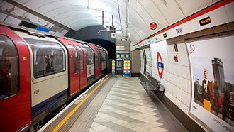 Bank and Monument stations - Central line train on the westbound platform.