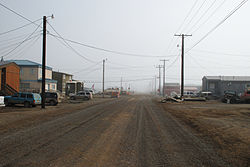 Street view of Barrow in July 2008.  This street, like all the others in Barrow, has been left unpaved due to the prevalence of permafrost. It creates problematic maintenance issues for paved streets.