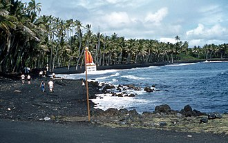 Kaimū, Hawaii - Kaimū Beach, also known as Black Sand Beach, 1959. Beginning in 1983, eruption from the Kīlauea volcano began to affect the area, completely covering it by 1990.