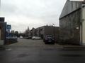Blik op de ingang van de Herman De Vosstraat.png