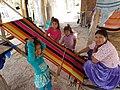 Bolivia Andean Women weaving a blanket.jpg