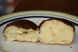 Interior view of a lightly filled Boston cream doughnut