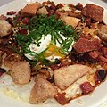 Breakfast Congee - bacon, Portuguese sausage, heritage Han, soft-poached egg, cheddar cheese, scallions, cinnamon bacon croutons (16269678756).jpg