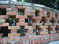 Brick wall with cruciform holes, Ika, Croatia.jpg