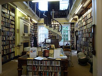Bromley House Library - A view of the main room. The spiral staircase is unusual in that it has no central supporting column.