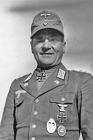 Oberst Hans Cramer wearing tropical uniform. Note the combination of green-backed M35-style collar Litzen and Panzer skulls on the lapels. - World War II German uniform