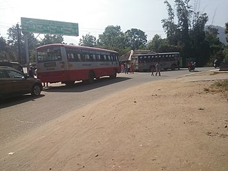 Mudumalai National Park - The Mysore-Ooty highway passes through the forest. The image shows KSRTC buses passing through the park at Theppakadu