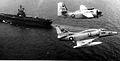 C-1A and A-4F in flight near USS Hancock (CV-19) 1975.jpg