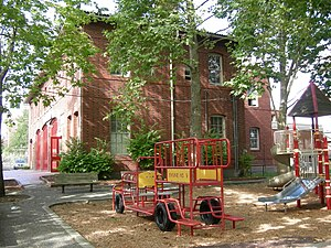 Playground in Firehouse Mini Park and, in back...