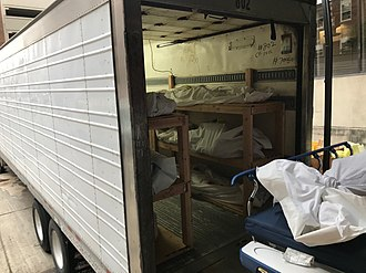 "Deceased in a 16 m (53 ft) ""mobile morgue"" outside a hospital in Hackensack, New Jersey COVID19 deceased in Hackensack NJ April 27.jpg"