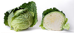 Cabbage and cross section on white