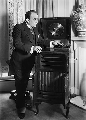 Victor Talking Machine Company - Enrico Caruso with a customized Victrola given to him as a wedding gift by the Victor Company in 1918