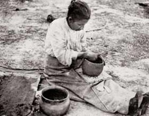 Olla - A Catawba potter making an olla, 1908