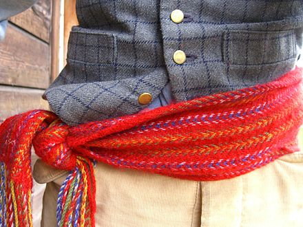 bd68a44b5142 A machine-woven modern arrow sash