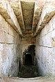 Cerveteri, necropoli della banditaccia, via sepolcrale principale, ingresso di una tomba con finta volta a gradoni.jpg