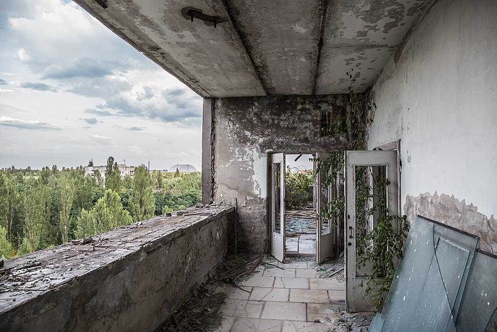 Chernobyl Hotel with reactor in background