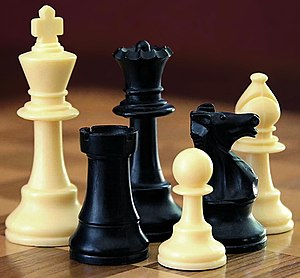 Chess - Part of a Staunton chess set  Left to right: white king, black rook, black  queen, white pawn, black knight, white bishop