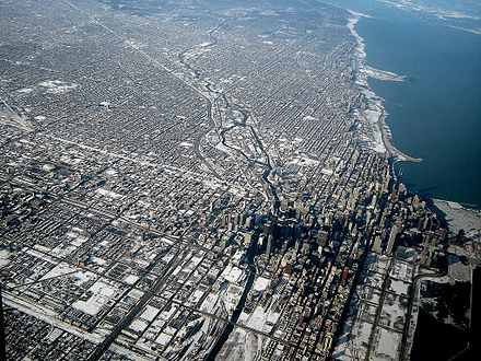 The City of Chicago, Illinois is an example of the early American grid system of development. The grid is enforced even on uneven topography. Chicago Downtown Aerial View.jpg