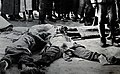 China, street scene of mutilated dead bodies of two women and another person, date unknown.jpg