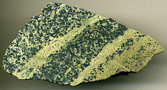 Serpentinite - Chromitic serpentinite  (7.9 cm across), Styria Province, Austria. Protolith was  a Proterozoic-Early Paleozoic upper mantle dunite peridotite that has been multiply metamorphosed during the Devonian, Permian, and Mesozoic.