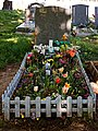 City of London Cemetery picket fence grave with plastic flower bed 1.jpg