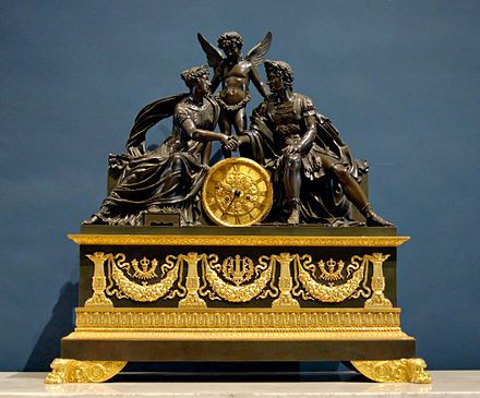 A French Empire mantel clock representing Mars and Venus, an allegory of the wedding of Napoleon I and Archduchess Marie Louise of Austria. By the famous bronzier Pierre-Philippe Thomire, ca. 1810. Clock Thomire Louvre OA9511.jpg