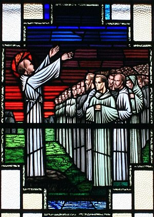 Finnian of Clonard - St. Finnian and his pupils in a stain glass window at the Church of St. Finian in Clonard
