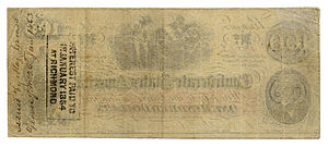 """Confederate war finance - The Confederate """"Greyback"""". Note the stamp which indicates interest paid. Interest-paying money was one of the unique aspects of Confederate public finance."""