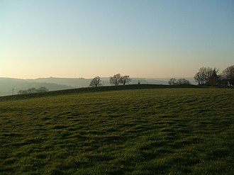 Scheduled monument - Cranmore Castle in Devon is an Iron Age earthwork. Like many scheduled monuments, it blends into the landscape, and may not be evident even to those crossing over it.