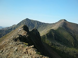 "Snowdon - The ""knife-edge"" arête of Crib Goch (foreground) and the pyramidal peak of Snowdon (background) are both the result of glaciation."