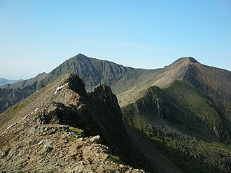 "Snowdon - The ""knife-edge"" arête of Crib Goch (foreground) and the pyramidal peak of Snowdon (background) are both the result of glaciation"