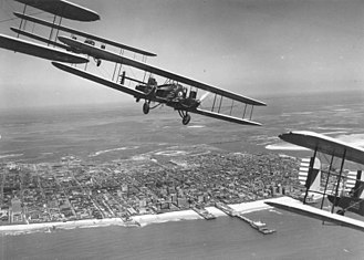 7th Operations Group - Curtiss B-2 Condor formation flight over Atlantic City, N.J. S/N 28-399 is in the foreground (tail section only). Aircraft were assigned to 11th Bombardment Squadron, 7th Bombardment Group at Rockwell Field, California. This flight of 4 aircraft completed cross-country flight to Atlantic City, NJ.