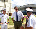 David Olson, son of Navy Commander Delbert Olson talks about his father with some Naval officers following a repatriation ceremony held July 10, 2001 at Hickam AFB, Hawaii 010710-F-TV770-005.jpg