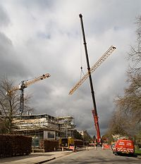 A telescopic crane dismantling a 40 m tower crane in Cambridge, UK