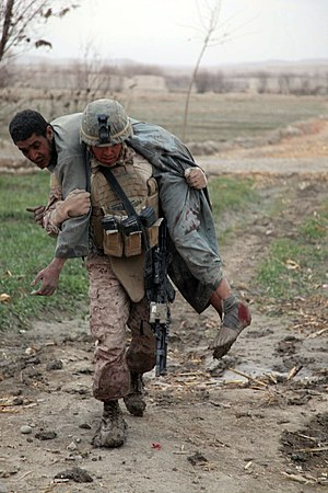 Fireman's carry - A US Marine carrying an injured Afghan after an IED blast, 2011.