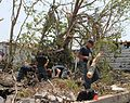 Defense.gov News Photo 110607-N-ZZ999-003 - Petty Officer 2nd Class Pat Patterson left Lt. j.g. Joe Innerst Petty Officer 2nd Class Travis Fitzgerald and Lt. Ryan Sullivan clear debris.jpg
