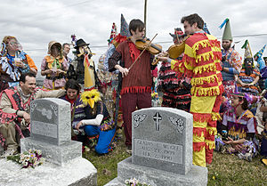Dennis McGee - Linzay Young sings with Chris Stafford, Joel Savoy, and Tony Davoren at a Courir de Mardi Gras  by Dennis McGee's grave.