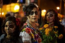 women with calaveras makeup celebrating dia de muertos in the mission district of san francisco california