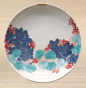 Kintsugi - Small repair (top) Nabeshima ware dish with hollyhock design, overglaze enamel, 18th century, Edo period